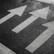 Pedestrian crossing road marking with white arrows on asphalt — Stock Photo