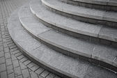 Curved modern gray stone stairs in the city — Stock Photo