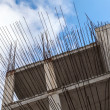Modern building under construction, fragment with concrete walls and metal armature — Stock Photo