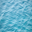 Blue sea water photo background texture with ripple — Stock Photo