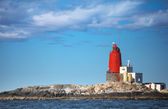 Grinna - old Norwegian lighthouse with large red tower on Rocky Island. It was established in 1904 — Stock Photo