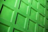 Abstracte fragment van helder groen betonnen hek muur — Stockfoto