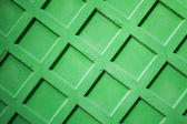 Abstract photo texture of bright green concrete fence wall — Stock Photo