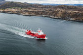 Small Norwegian red oil products tanker sails in the fjord — Stock Photo