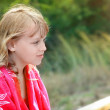 Outdoor summer portrait of Little blond girl in red shawl — Stock Photo