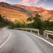 Curved  mountain highway in soft early morning sun light — Stock Photo