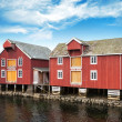 Red wooden houses in small Norwegian fishing village — Stock Photo