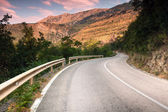 Montenegro, curved mountain highway in soft early morning sun light — Stock Photo