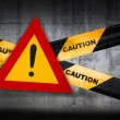 Warning sign with exclamation mark on striped caution tape — Stockfoto