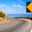 Turn of mountain highway with blue sky and sea on a background — Stock Photo