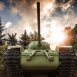 Stock Photo: Soviet heavy KV-85 tank from Second World War with forest and dramatic sky on background. Monument in St-Petersburg