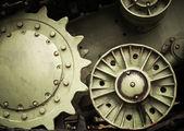 Heavy industry engineering background with dark green tractor gears — Stockfoto