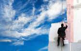 Painter paints bright blue sky on the urban wall — Stock Photo