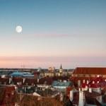 St. Nicholas Church and moon in old town of Tallinn, Estonia — Stock Photo #32523075