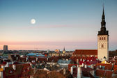 St. Nicholas Church and moon in old town of Tallinn, Estonia — Stock Photo