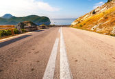 Double dividing line on the coastal mountain highway in Montenegro — Stock Photo