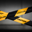 Black and yellow striped caution tape barrier — Stock Photo #32639607