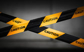 Black and yellow striped caution tape barrier — Stock Photo