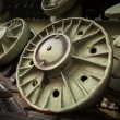 Heavy industry photo background with dark green tractor gears — Stock Photo
