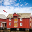 Red and yellow wooden coastal house in Norwegian fishing village. Rorvik, Norway — Stock Photo #32880619