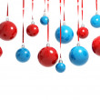 Blue and red Christmas balls hanging on ribbons isolated on white — Stock Photo #33122021