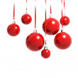 Red Christmas balls hanging on ribbons isolated on white — Stock Photo