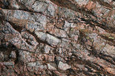 Dark granite rock closeup photo background texture — Stock Photo