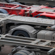 Stock Photo: Industrial automotive transportation photo background with empty trucks cargo trailers