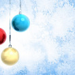 New Year background illustration with three Christmas balls hanging on ribbons above blue frozen glass surface — Stock Photo