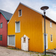 Stock Photo: Small town street with red and yellow wooden houses in Norway