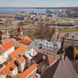 Aerial view on old town and passenger port in Tallinn, capital city of Estonia — Stock Photo #33584365