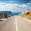 Stock Photo: Dividing line and right turn sign on the coastal mountain highway in Montenegro