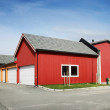 Traditional rural red and yellow wooden Norwegian garages — Stock Photo #34043699