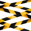 Black and yellow caution striped tapes isolated on white background — Stock Photo