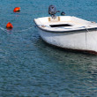 White wooden fishing boat floats moored in Adriatic sea water — Stock Photo