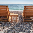Two wooden sun loungers stand on the Adriatic Sea beach in Montenegro — Stock Photo