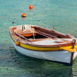Wooden fishing boat floats moored in Adriatic sea — Stock Photo