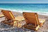 Two wooden sun loungers stand on the Adriatic Sea coast in Montenegro — Stock Photo
