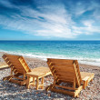 Two wooden sun loungers stand on the beach in Montenegro — Foto Stock
