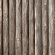 Old brown wooden wall of rural house made of logs — Stock Photo