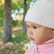 Closeup portrait of little baby girl on the walk in autumn park — Stock Photo
