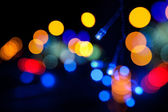 Colorful LED (light emitting diodes) lights garland with bokeh effect on black background — Stock Photo
