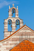 Bell tower of the Serbian Orthodox Church in the Gradiste monastery, Montenegro — Stock Photo