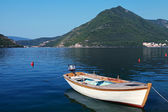 White wooden fishing boat floats moored in Perast town, Adriatic sea, Montenegro — Stock Photo