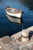 White wooden fishing boat floats moored in Perast town, Montenegro — Foto Stock