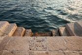 Stone stairs to the shining sea water. Perast town, Montenegro — Stockfoto