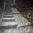 Old stone stairway goes up on the street of Perast town, Montenegro — Stock Photo