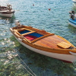 Wooden fishing boats float moored in Adriatic sea water. Petrovac town, Montenegro — Stock Photo