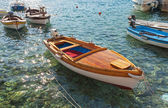 Wooden fishing boats float moored in Adriatic sea water. Petrovac town, Montenegro — ストック写真