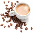 Small espresso cup with coffee beans isolated on white — Stock Photo